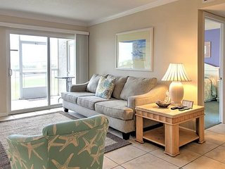 Ground floor end unit - literally steps to the wonderful beach (122)