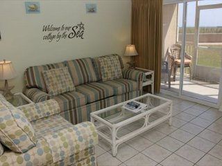 Walk out your patio door and be steps from the beach! 1 BR condo #120