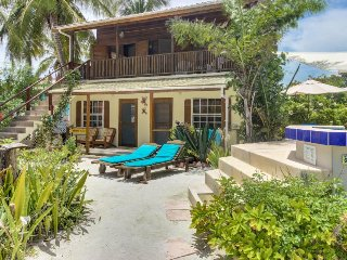 Breezy home with shared pool only moments from the beach!