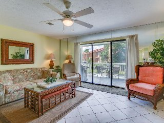 Dog-friendly townhouse w/ private golf cart, canal views, shared pools & more!