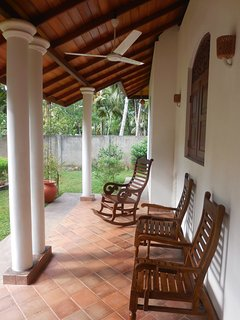 Front porch with comfortable Chairs to Relax your hard day at the beach!