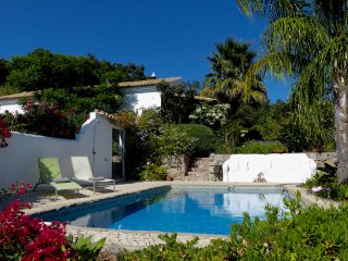 Secluded stylish Monchique home, private pool, lush gardens, stunning sea views.