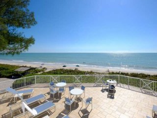 Enjoy stunning sunsets on the beautiful gulf front deck just down the hall from your condo!