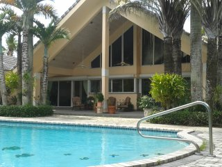 Fabulous gated luxury furnished house in a lush palm tree tropical garden