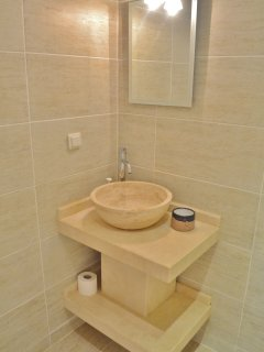 The shower room's stone sink