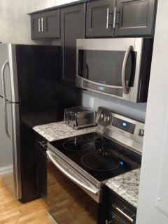 New Convection oven and combination microwave and convection oven on top as well.