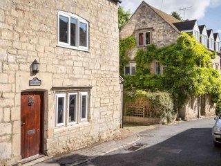 Belleview is part of a row of traditional Cotswold stone cottages in Painswick