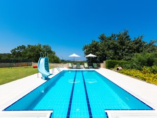 Swimming pool area with sun beds pool alarm system for children's
