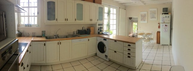 A panorama of the kitchen, fully equipped with everything you'll need and table and chairs for 4.