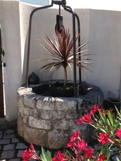 The well in front of our house which led us to name our little residence Résidence du Petit Puits.