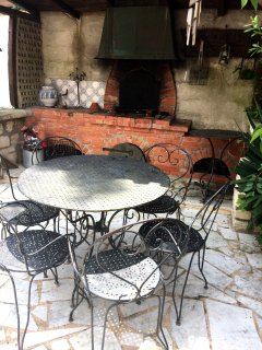 Garden: the brick built barbecue and table and chairs.