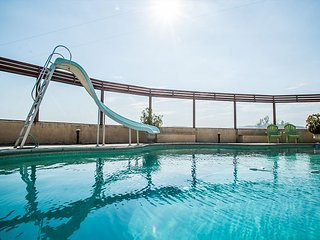 Come for the Views and Pool, Stay for the Retro Fun and Style!