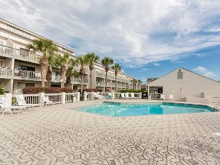 Renovated 1BR w/ Patio, 2 Pools & Hot Tub – Steps to Beach & Dining