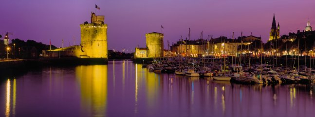 By night, La Rochelle's stunning port, about 25-30 minutes leisurely walk from the house.