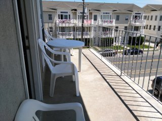 View from your deck out to boardwalk, beach, and ocean. Park your car and walk to everything.