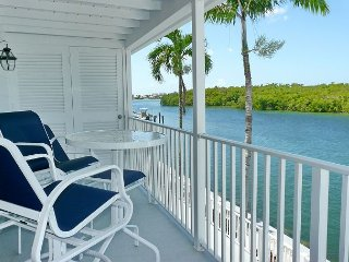 Peaceful waterfront condo w/ heated pool in charming Olde Marco