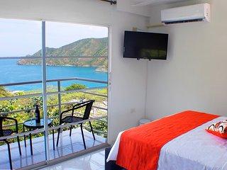 SMR554A - Habitación Superior con Balcón Suitehouse Taganga
