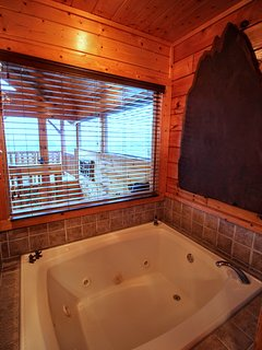 2 PERSON JACUZZI WITH VIEW, HOOKS FOR TOWELS, AND A DIMMABLE LIGHT. BEAUTIFUL WALNUT SLAB ART.