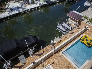 **Winter Promo**  Elite Home with Luxury Amenities, Heated Pool, Dock & Minutes