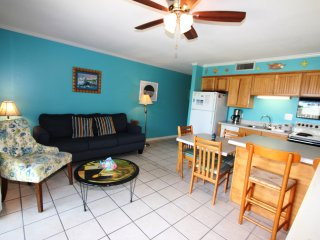 Adorable townhome located steps from the beach!!! Pool & laundry facility onsite