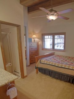 Bedroom 2 has a Queen bed, vaulted ceilings, HDTV, and private bathroom