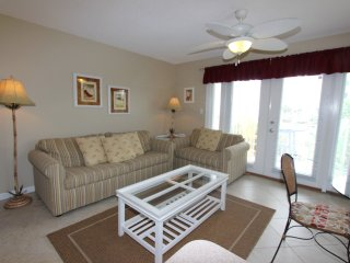 Beautiful condo with gulf views!! Steps from the beach, pool & laundry onsite!!