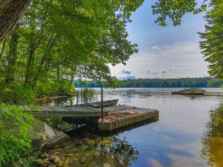 Lakefront views at this charming cottage with private dock, dog-friendly!