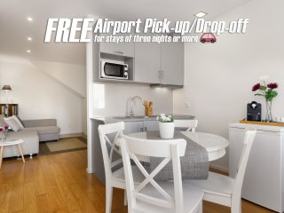 FREE Airport Pick-up/Drop-off | Town Center Duplex Apartment with Red Roof View