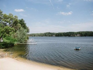 You have a front row seat - savor the autumn beauty surrounding Lake Delton