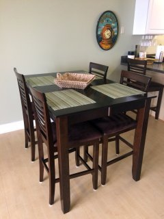 Large Dining Table in main living area is wonderful for dinners and game nights!