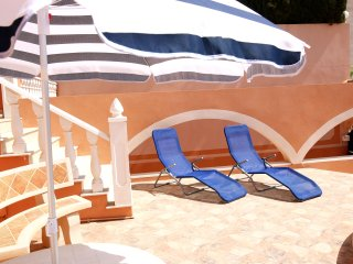 Relax on the sun loungers to top up your tan.