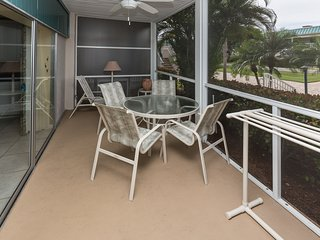 Our bright and comfortable front lanai with a garden view - and the beach is steps away!