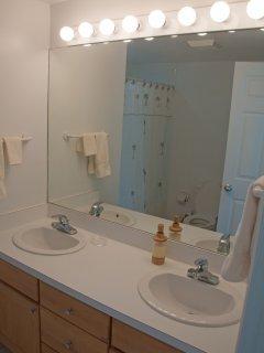 Double sinks in the green room en suite bathroom.