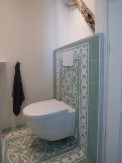 Tiled toilet.