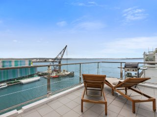 Glamorous 2BR Waterfront Sub-Penthouse with Panoramic Ocean Views