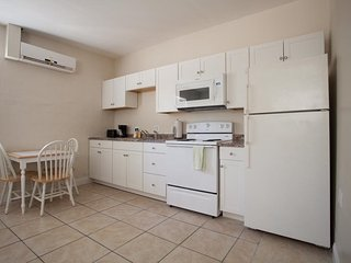 Full Modern Kitchen, Range, Refrigerator, Microwave, central air conditioning.