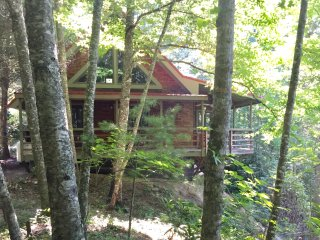 View of our beautiful redwood bricks cabin, as you are approaching from the gravel driveway.