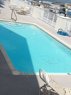Outdoor pool is 1 floor below condo