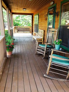 Enjoy a morning cup of coffee or evening glass of wine in one of these rocking chairs on the covered front porch.