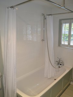 Bath with shower over