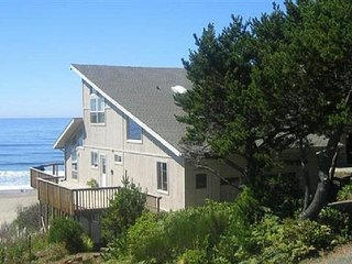 Enjoy the views from this oceanfront home with private beach access!
