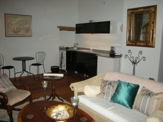 Kitchenette and lounge area, with cathedral ceiling large arched windows several sofas