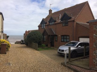 Stunning holiday home only yards from blue flag beach