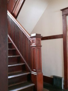 Bannister heading upstairs