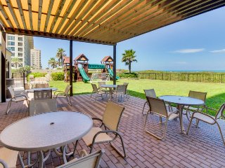 Corner beachfront condo features ocean views, shared pool, hot tub, tennis