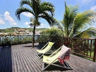 Tropical Sunset, appartement moderne avec vue d'exception sur la mer turquoise
