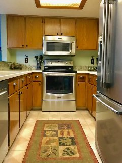 The kitchen is fully stocked with all necessities and new stainless appliances!