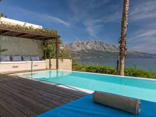 Villa Madouri. Luxury seafront villa with pool.