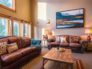 Main level lounge with leather couches and large gas fireplace