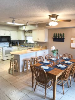 Spacious kitchen with dishwasher, microwave and coffee maker.